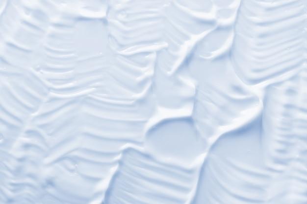 Lichtblauwe cosmetische crème textuur