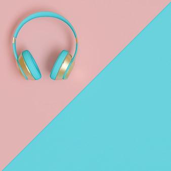 Lichtblauwe en gouden audiohoofdtelefoons op een platliggende tweekleurige achtergrond.