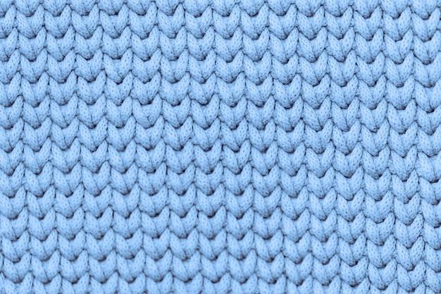 Lichtblauwe gebreide textuurachtergrond