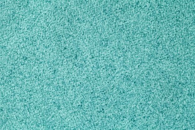 Lichtblauwe pluizige achtergrond van zachte, veloursstof. textuur van turkooise wol textielachtergrond, close-up.
