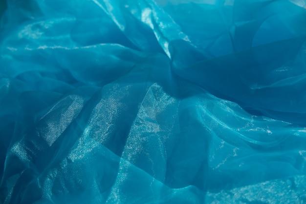Lichtblauwe textuur die als achtergrond wordt gebruikt. blauwe lichte stoffentextuur.