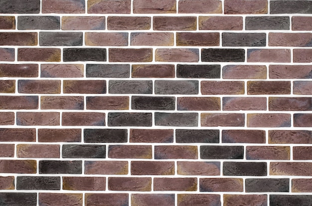 Lichtbruine bakstenen muur met patroon