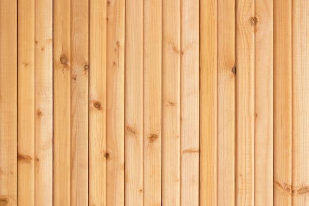 Lichtbruine houten de textuurachtergrond van de plankenmuur.