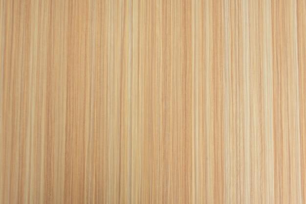 Lichtbruine houtnerftextuur die als achtergrond wordt gebruikt.