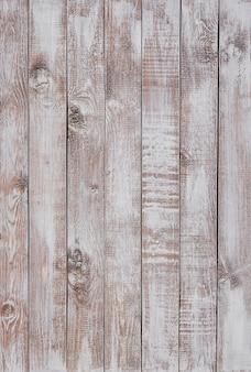 Lichte houten achtergrond gemaakt van een smal bord, geverfd in bruin, lichtbeige.