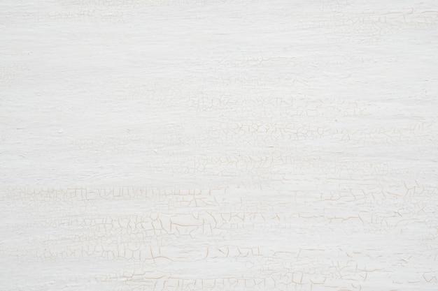 Lichte houten oppervlak met scheuren als achtergrond