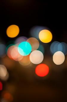 Lichten van bokeh op zwarte achtergrond