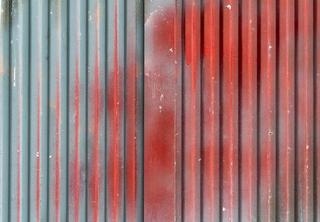 Lichtgekleurde harde plaattextuur met rode kleur