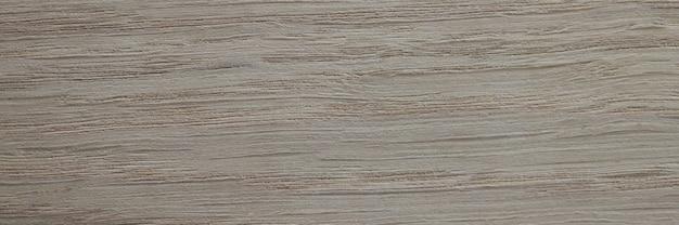 Lichtgrijze houten plankclose-up
