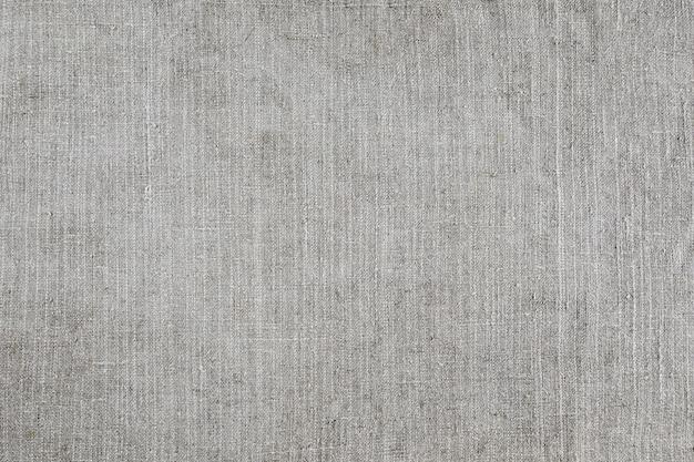 Lichtgrijze natuurlijke linnentextuur voor de achtergrond. sluit omhoog van oude doek