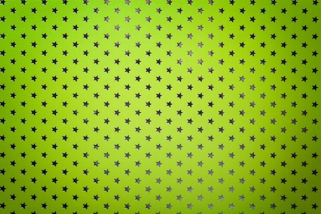 Lichtgroene achtergrond van metaalfoliepapier met een zilveren sterrenpatroon.