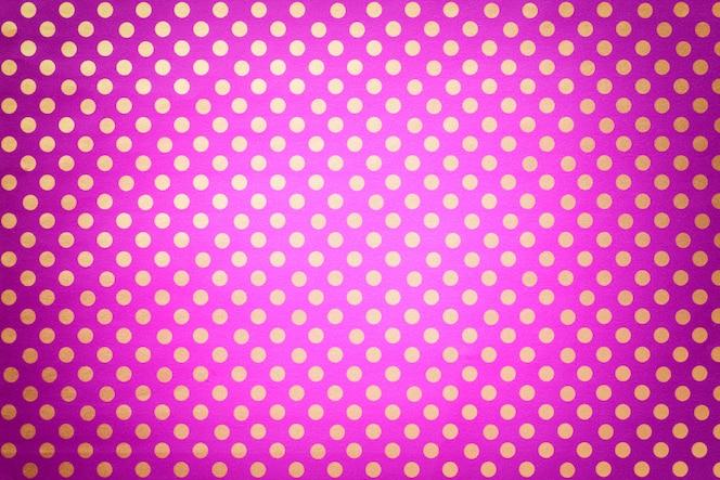 Lichtpaars van cadeaupapier met een patroon van gouden polka dot