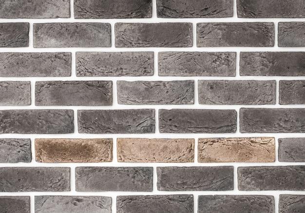 Lichtrode bakstenen muur, creatieve back-phonon, close-up
