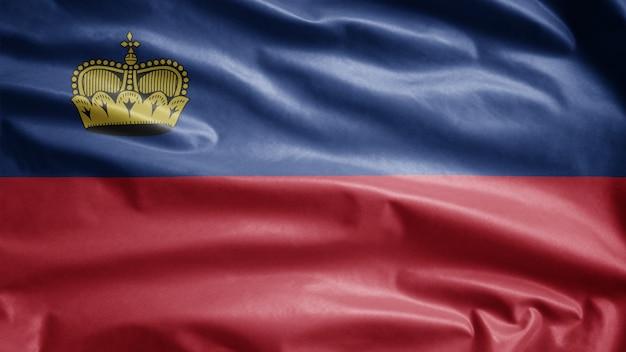 Liechtensteiner vlag zwaaien in de wind. close up van liechtenstein banner waait, zacht en glad zijde. doek stof textuur vlag achtergrond.