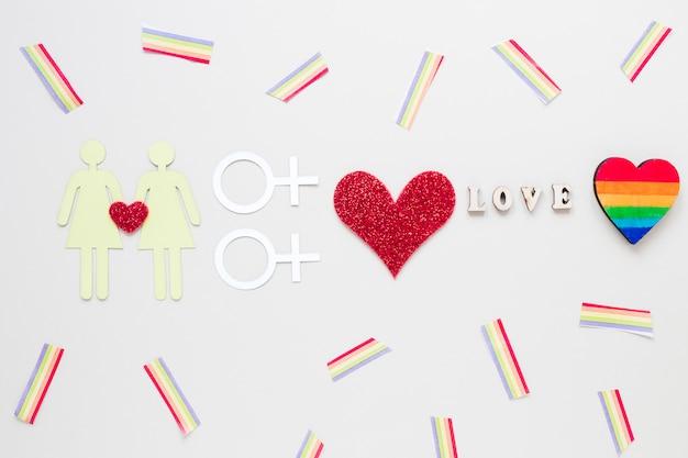 Liefde inscriptie met lesbische paar pictogram en regenboog hart