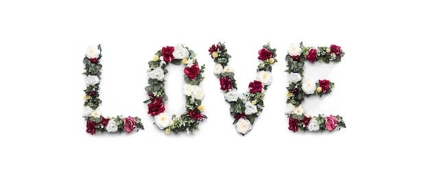 Liefdewoord van bloemen op wit wordt gemaakt dat