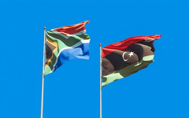 Lijst van vlaggen van libië en sar-afrikaanse op blauwe hemel. 3d-illustraties
