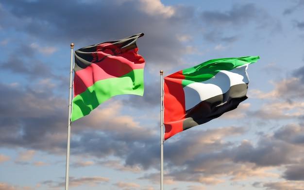Lijst van vlaggen van malawi en de arabische emiraten van de vae op blauwe hemel. 3d-illustraties