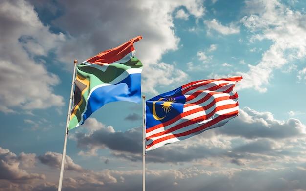 Lijst van vlaggen van maleisië en sar afrikaanse op blauwe hemel. 3d-illustraties