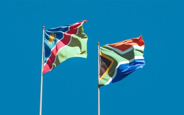 Lijst van vlaggen van namibië en sar-afrikaan op blauwe hemel. 3d-illustraties