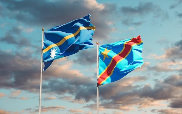 Lijst van vlaggen van nauru en dr congo op blauwe hemel. 3d-illustraties