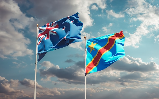 Lijst van vlaggen van nieuw-zeeland en de dr congo op blauwe hemel. 3d-illustraties