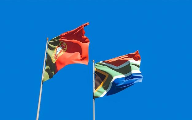 Lijst van vlaggen van portugal en sar afrikaanse op blauwe hemel. 3d-illustraties