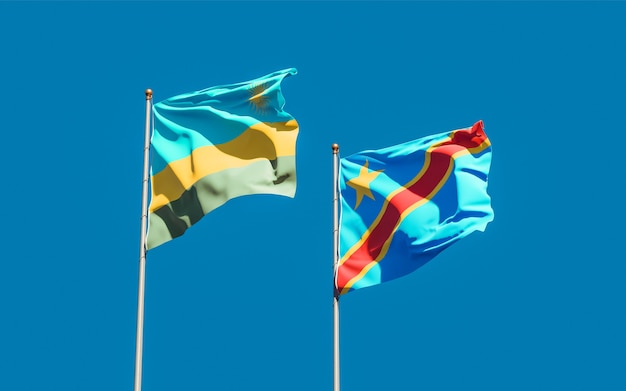 Lijst van vlaggen van rwanda en dr congo op blauwe hemel. 3d-illustraties