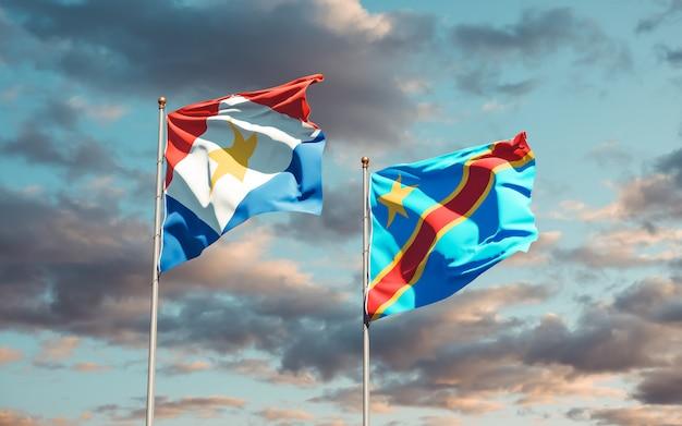 Lijst van vlaggen van saba en dr congo op blauwe hemel. 3d-illustraties