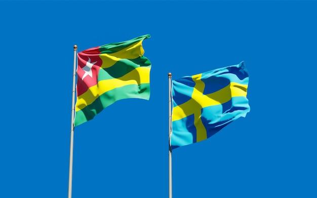 Lijst van vlaggen van togo en zweden op blauwe hemel. 3d-illustraties