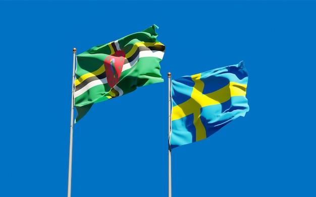 Lijst van vlaggen van zweden en dominica op blauwe hemel. 3d-illustraties