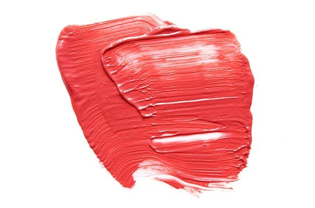 Lippenstift beroerte geïsoleerd op wit oppervlak