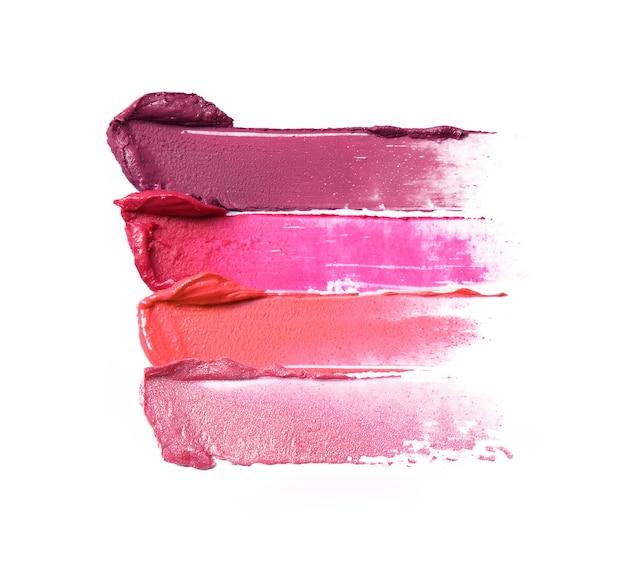 Lippenstift penseelstreken in verschillende tinten geïsoleerd op wit