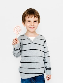 Little boy hands holding marshmallow candy studio portret