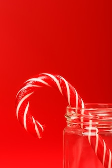 Lolly riet van het suikergoed in een glazen pot