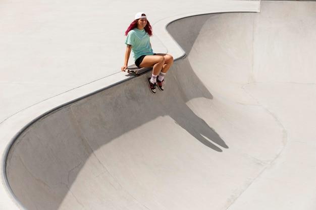 Long shot skater met board in park