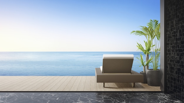 Lounge stoel op terras bij woonkamer in modern strandhuis