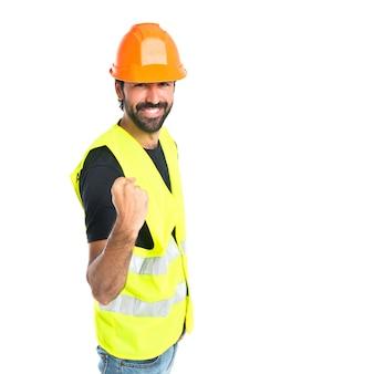 Lucky workman over geïsoleerde witte achtergrond