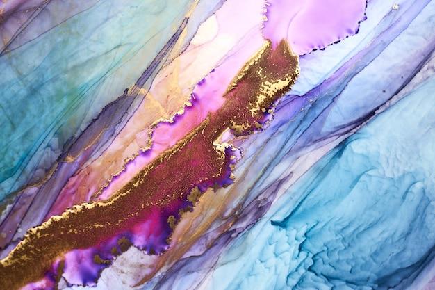 Luxe kleurrijke abstracte achtergrond in alcohol inkt techniek, gouden vloeibare schilderij marmeren textuur, verspreide acryl blobs en wervelende vlekken, drukwerk
