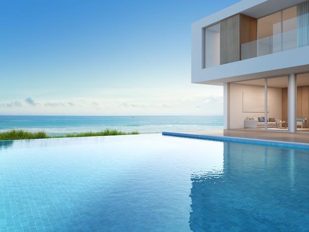 Luxe strandhuis met zeezicht zwembad in modern design.