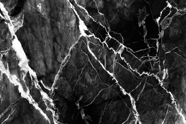 Luxe van zwarte marmeren textuur met natuurlijk patroon voor achtergrond of ontwerpkunstwerk.