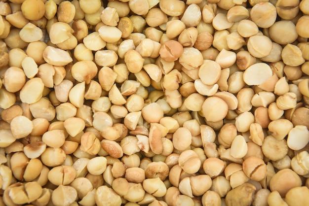 Macadamia notentextuur achtergrond met gedroogde verse macadamia noot gepeld van natuurlijk eiwitrijk tot te drogen