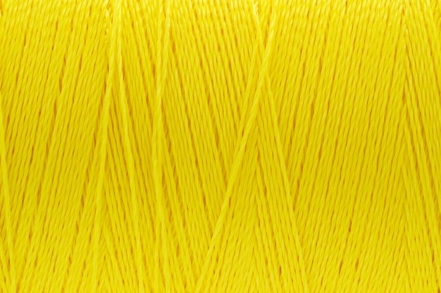Macrobeeld van gele de kleurenachtergrond van de draadtextuur