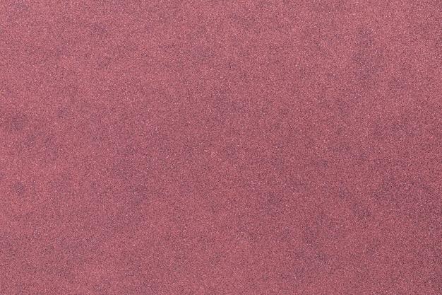 Macrofoto van magenta, paars glitter gestructureerde achtergrond (macro focus op textuur)
