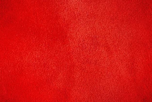 Macrofoto van rood suèdeleer. de textuur is fluweelrood.