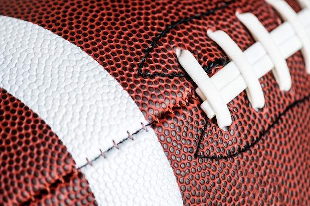 Macroschot van de amerikaanse achtergrond van de voetbalbal