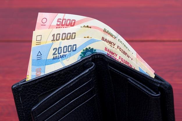 Madagaskar geld in een zwarte portemonnee