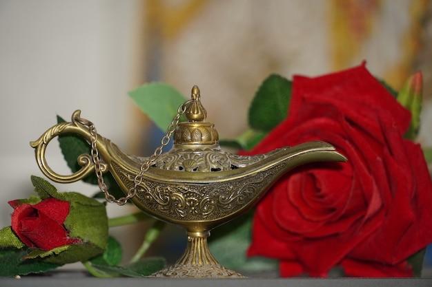 Magische lampafbeeldingen met roos hd jin lamp