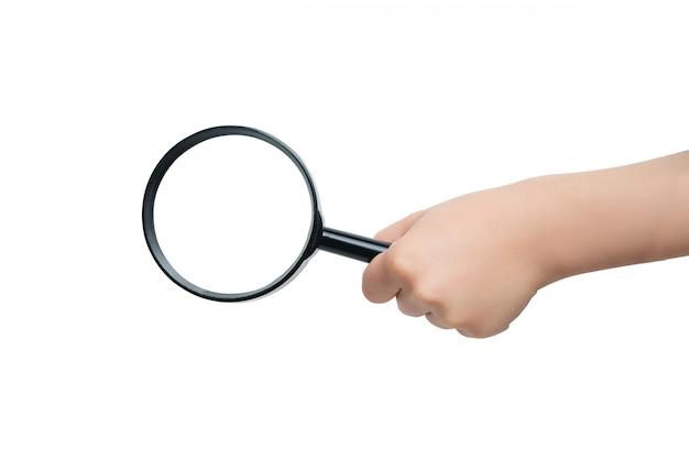 Magnifier in een hand van kinderen op een witte achtergrond. detailopname