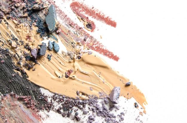 Make-up, cosmetische penseelstreken, uitstrijkjes. mascara, toon, oogschaduw.